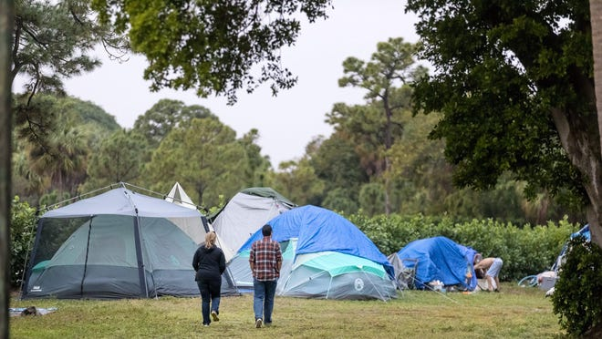 County workers head out to talk to homeless people at the camp in John Prince Park during the annual Palm Beach County homeless count Friday, January 24, 2020.