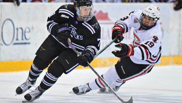 Minnesota State-Mankato's Steen Cooper skates past