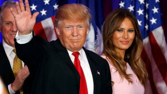 Donald Trump waves with his wife, Melania, at a rally