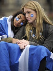 Pro-independence supporters console each other Friday in George Square in Glasgow, Scotland.