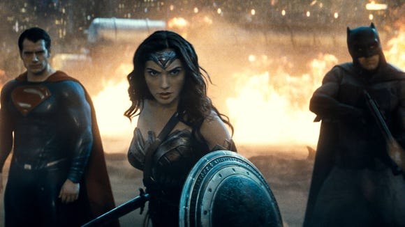 """This image released by Warner Bros. Entertainment shows Henry Cavill as Superman, left, Gal Gadot as Wonder Woman and Ben Affleck as Batman in a scene from """"Batman v Superman: Dawn of Justice."""""""