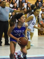 Notre Dame's Demie Brennan (24) gains possesion of the ball against the Academy of Our Lady of Guam Cougars during their Independent Interscholastic Athletic Association of Guam Girls' Basketball League game at the Academy Gym in Hagatna on Nov. 23.