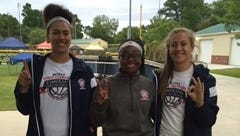 Carolina Day throwers, from left to right, Halei Gillis, Mikayla Ray and Tess Harris.
