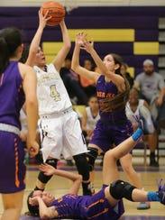 Burges' Melinda Vargas grabbed a rebound Monday.