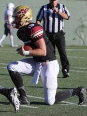 Midwestern State quarterback Layton Rabb takes a knee to end the playoff game against Sioux Falls Saturday, Nov. 18, 2017, at Memorial Stadium. The Mustangs defeated the Cougars 24-20 in the first round of the NCAA DII Playoffs.