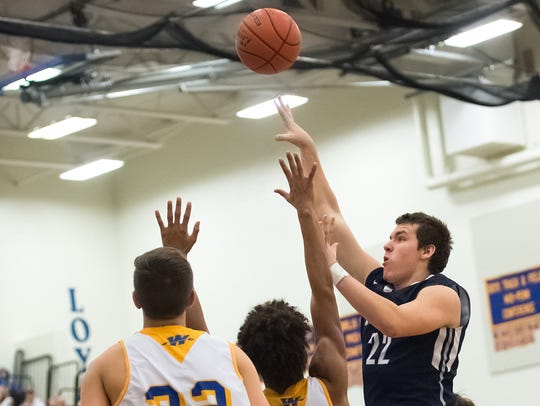 Chambersburg's Cade Whitfield (22) makes a shot while