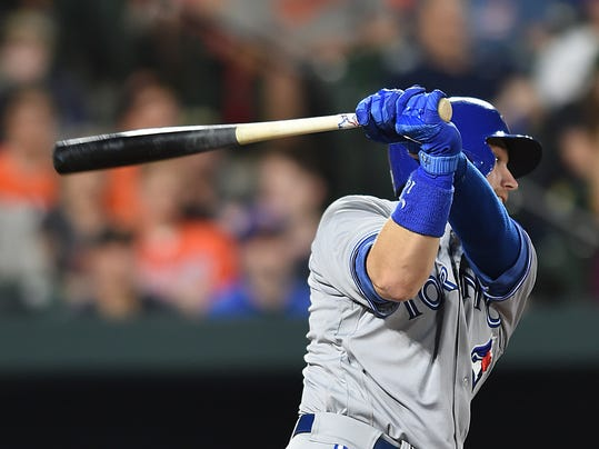 Toronto Blue Jays' Justin Smoak connects for a two-run single against the Baltimore Orioles during the fourth inning of a baseball game, Friday, May 19, 2017, in Baltimore. (AP Photo/Gail Burton)