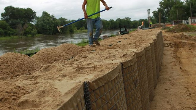 Flood preparations on Wednesday, July 2, 2014.