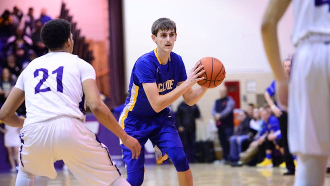 Clyde's Seth Hohman looks at options against Fremont Ross. Hohman scored 35 points Saturday in a win over Bellevue.