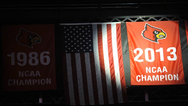The University of Louisville unveiled its 2013 NCAA National Championship basketball banner before the start of the game against The College of Charleston.  By Pat McDonogh, The Courier-journal.  Nov 9, 2013