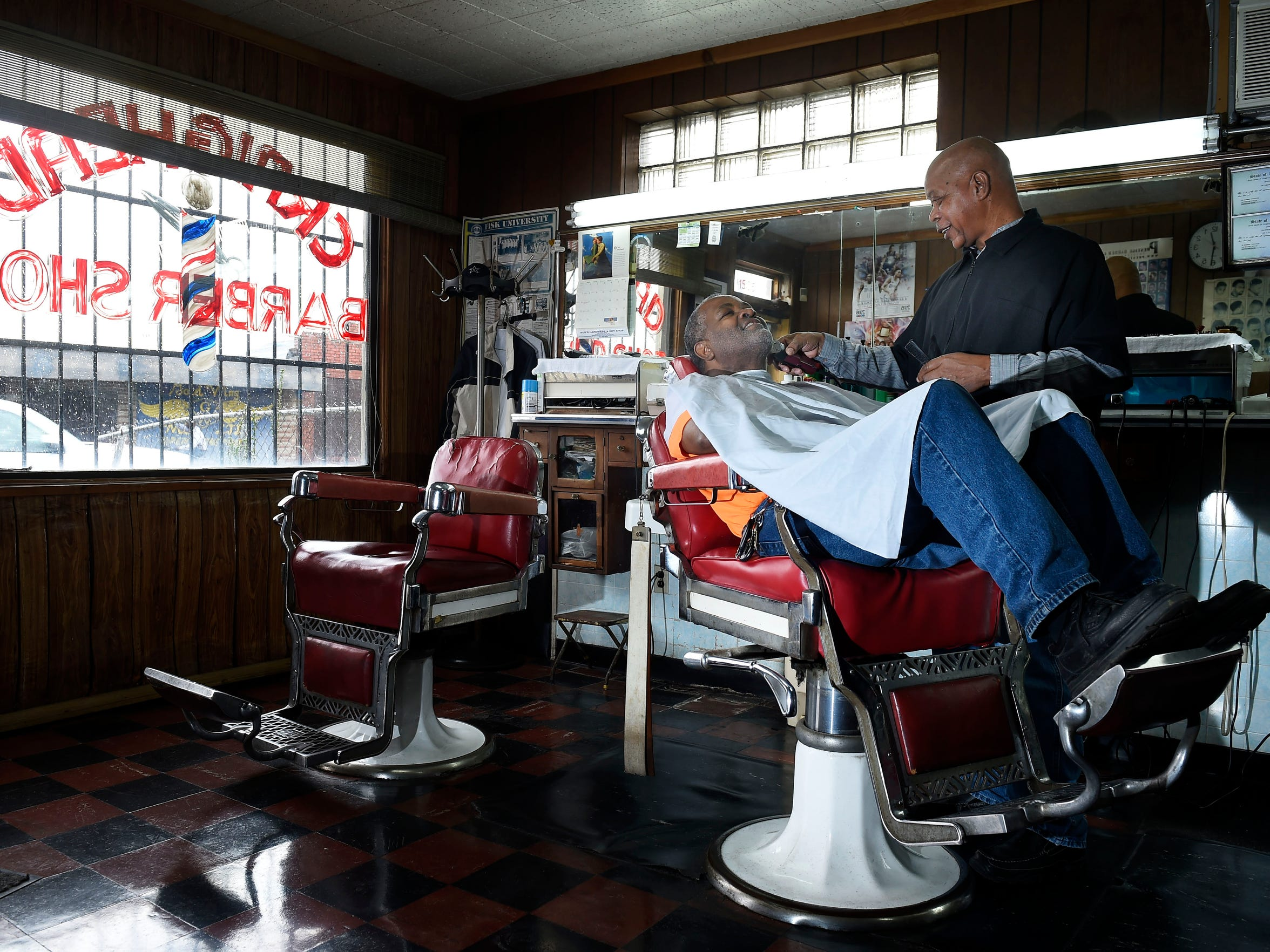 Barber Joe Trotter cuts Larry Tyner's hair at his Jefferson