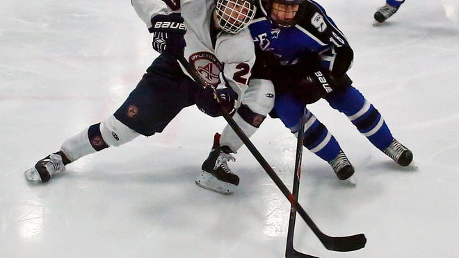 Connor Zilisch of Appleton United (left) and Johnny Welsch of Fond du Lac Springs battle in boys' hockey at the Appleton Family Ice Center on Thursday.