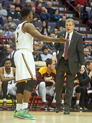 Iona coach Tim Cluess talks to Kelvin Amayo during Iona's 95-77 win over in a MAAC Championship semifinal game at the Times Union Center in Albany March 8, 2015.