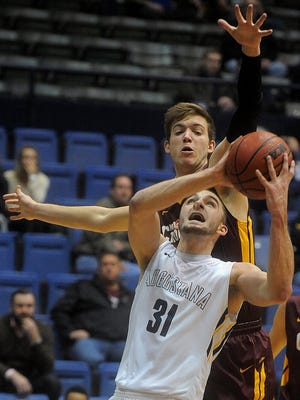 Augustana's Alex Richter goes up for a shot while University of Minnesota Crookston's Gable Smith defends during their game at Sioux Falls Arena on Wed., Feb. 24, 2016.