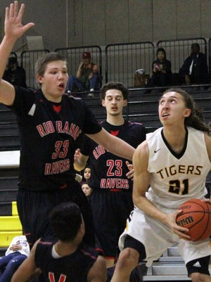 Alamogordo's Rakim Stokes, right, eyes the basket while being guarded by Rio Grande's Michael Dzula on Saturday afternoon at the Tiger Pit.