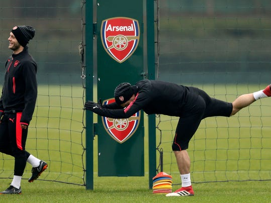 Arsenal's Henrikh Mkhitaryan, right, and Arsenal's Jack Wilshere attend a training session with teammates at London Colney, Wednesday Feb. 21, 2018. (Adam Davy/PA via AP)