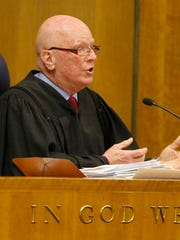 Judge Robert Noonan asks the Attorney General's Office for more information in the LDC corruption case during a hearing Dec. 18 in Monroe County Court.