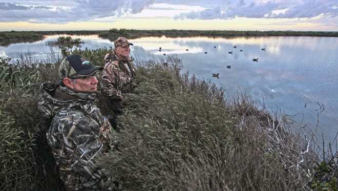 This blind built by Bay Flats guide Harold Dworaczyk is perfectly disguised as part of a mangrove island in a Matagorda salt marsh. That's outdoor writers/photographer Lefty  Ray Chapa on the left.