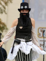 Contestants compete in the Beard and Mustache Competition during the Steampunk and Makers Fair Saturday, November 15, 2014, at Parc Sans Souci in Lafayette, La.