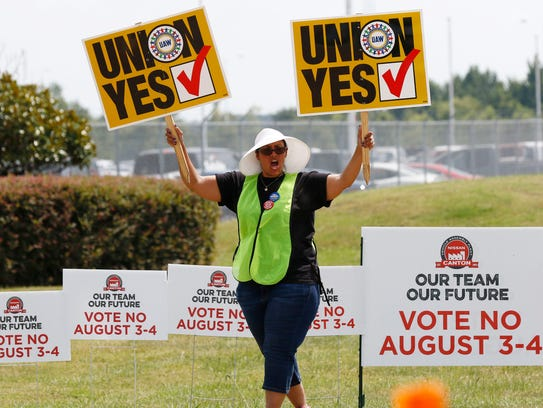 FILE - In this Aug. 4, 2017, file photo, a UAW supporter