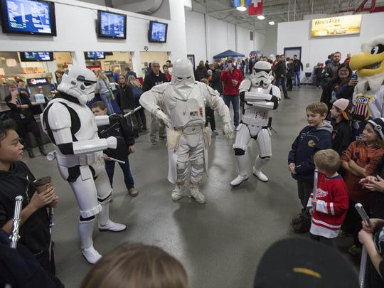 Fans and Star Wars characters mingle during Saturday's hockey game at USA Hockey Arena.