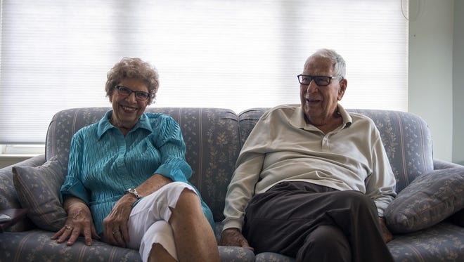 Fred Meserall, right, with his wife, Betty Meserall, inside their home in August.