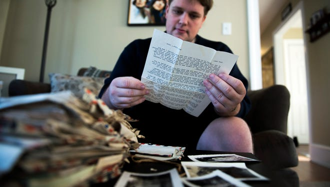 Dylan Berwick looks through letters dated back to the 1940s inside his home Wednesday in Audubon. About 50 letters, dated from 1942-1945 show correspondence between members of the Hazelton family from Callingswood.