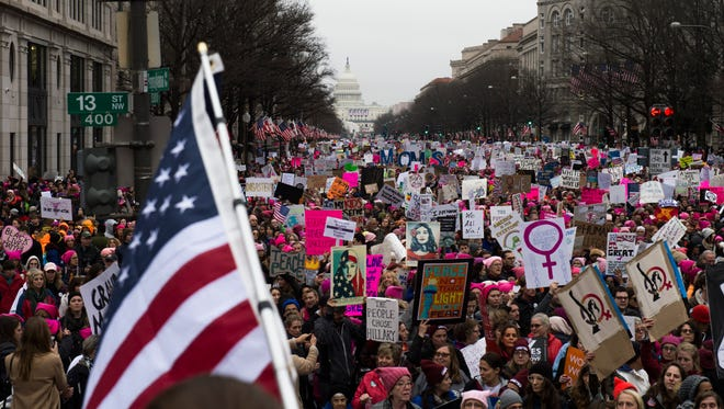 Thousands of marchers walk down Pennsylvania Ave in protest of newly elected president Donald J. Trump Saturday, Jan. 21 in Washington, D.C.