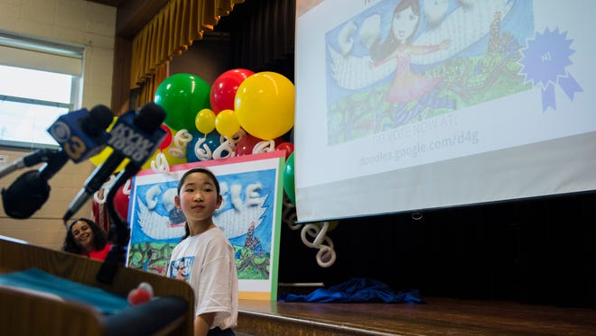 Third-grader Allison Kang, 9, is honored for winning the first phase of a 'Doodle 4 Google' competition Thursday at Sharp Elementary in Cherry Hill.