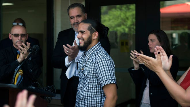 Benny Negron, 24, a former drug dealer, receives a round of applause after discussing how he turned his life around. His success story emphasizes a $500,000 grant from the U.S. Department of Labor announced Friday, at Cumberland County Jail in Bridgeton.