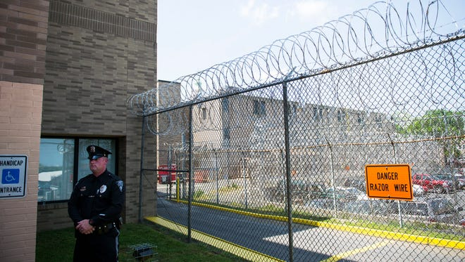 An officer stands outside the Cumberland County Correctional Facility in May 2017.