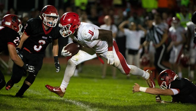 Rancocas Valley star senior tailback Iverson Clement carries the ball against Lenape in the Red Devils' 10-7 win on Oct. 6 in Medford. The teams will meet at Rowan University in Saturday's South Jersey Group 5 championship at 6 p.m.