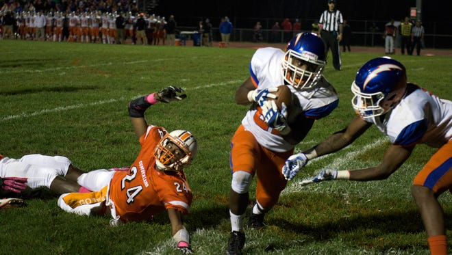 Millville's Dashon Byers (21) intercepts a ball in the end zone intended for Cumberland's James Bryant (24) Friday, Oct. 27, 2017 in Bridgeton. Millville won 42-6.