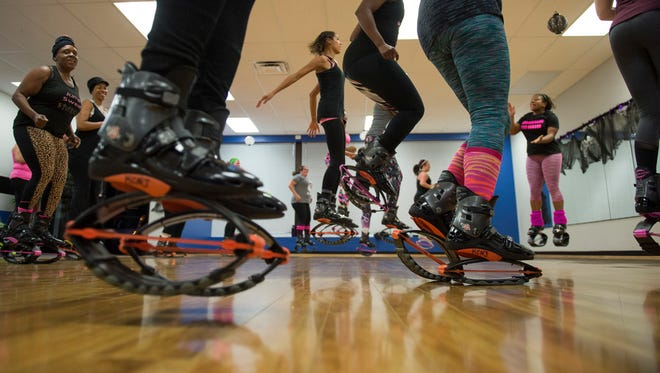 Attendees work out during a Kangoo Club fitness class Wednesday, Nov. 1, 2017 at Omega Sports in Sicklerville.