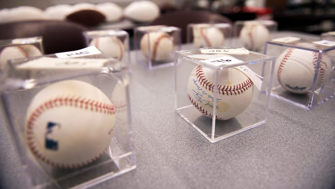 Various signed baseballs up for auction from the Burlington County Prosecutor's Office Tuesday, Nov. 14, 2017 in Westampton.