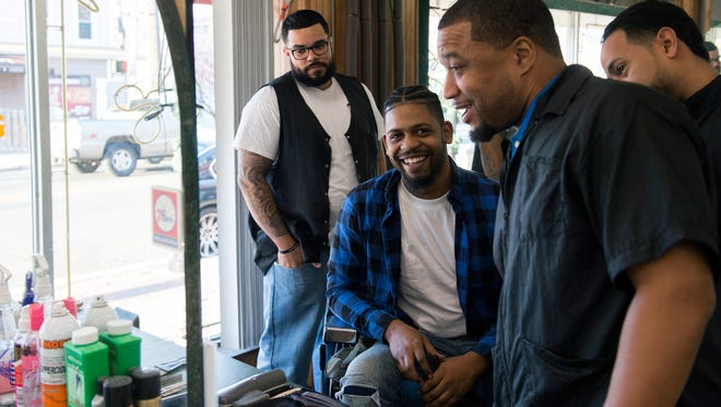 Barbers Frankie Ascencio, from left, Joe Perez, owner Andre Blalock and Rick Salas share a laugh Wednesday, Nov. 29 at Sheer Ambiance in Pennsauken.