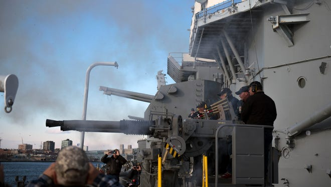 Smoke clears from a restored 40mm anti-aircraft gun as its fired during a ceremony commemorating the 75th anniversary of the USS New Jersey's launch Thursday, Dec. 7, 2017 in Camden.