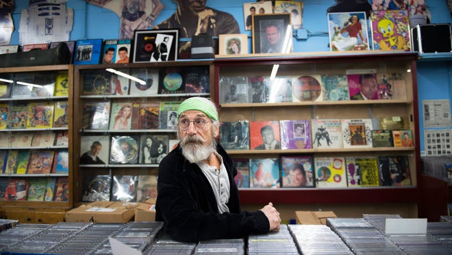 Joe DiPietro watches as customers browse the Record Store at the Berlin Farmers Market.