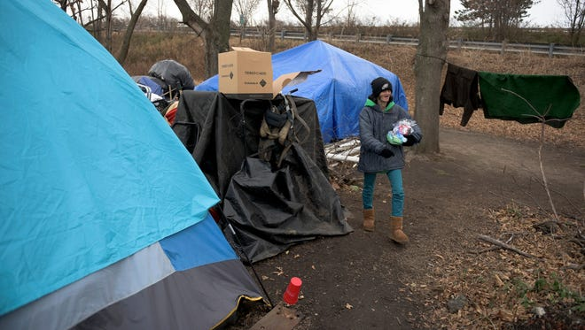 Mary Mead, 43, walks around her camp site in Camden after receiving a care package from the Camden County Sheriff's Office on Wednesday, Dec. 20, 2017.