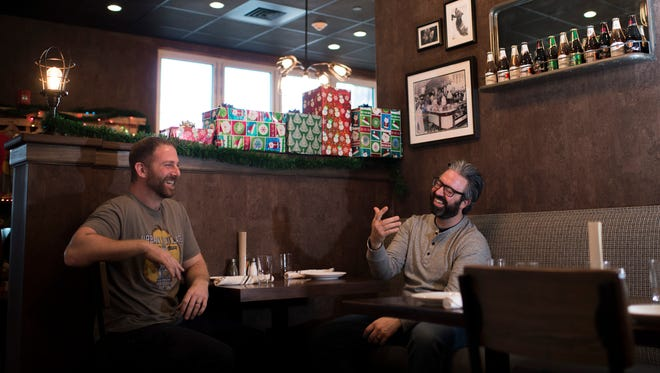 Owners Dave Goldman (left), and Tom Revelli share a laugh at Urban Village Brewing Company in Philadelphia.