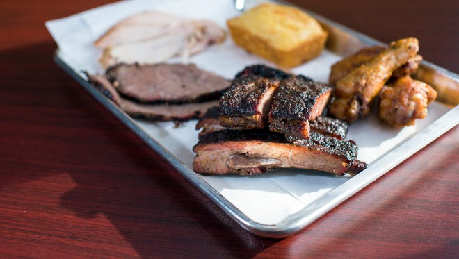 A tray of ribs, wings, brisket, smoked turkey and cornbread from Smoke BBQ in Audubon, New Jersey.