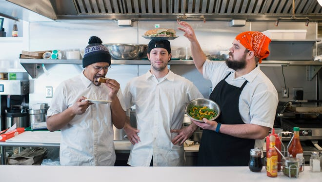 Server Mochi Robinson, from left, owner Matt Cahn and head chef Keith Krajewski inside Middle Child in Philadelphia. Cahn is from Cherry Hill.