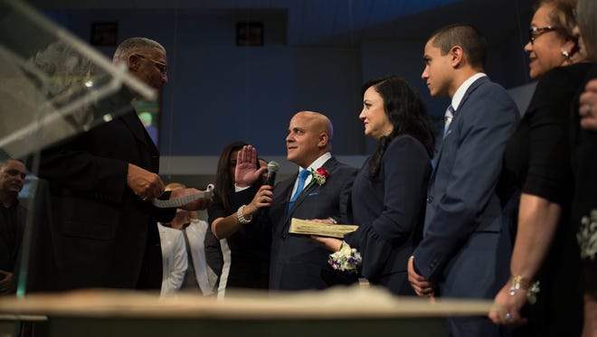 Francisco 'Frank' Moran is sworn in as Camden's new mayor as an inauguration ceremony is held Friday, Jan. 12, 2018 at Antioch Baptist Church in Camden, N.J.