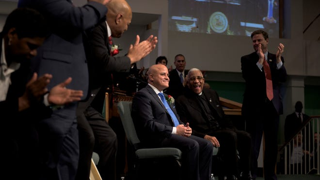 Francisco 'Frank' Moran receives a standing ovation as he becomes the new mayor of Camden Friday, Jan. 12, 2018 at Antioch Baptist Church in Camden, N.J.