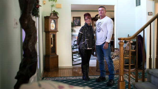 Patricia Cisco, left, poses inside her home with her son Chris Cisco Thursday, Jan. 25, 2018 in Sewell, N.J. Chris, who is now three years clean, went through an opioid addiction for many years.