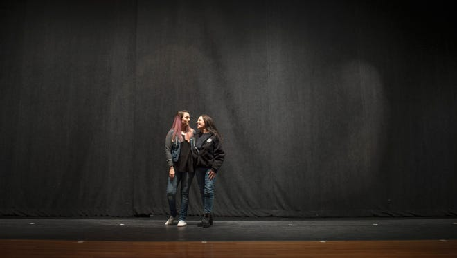 Charlene Maycott, right, poses on stage with her daughter Monica Maycott before an addiction awareness event Thursday, Jan. 25, 2018 at Williamstown High School in Williamstown, N.J. Monica is in recovery for heroin addiction.