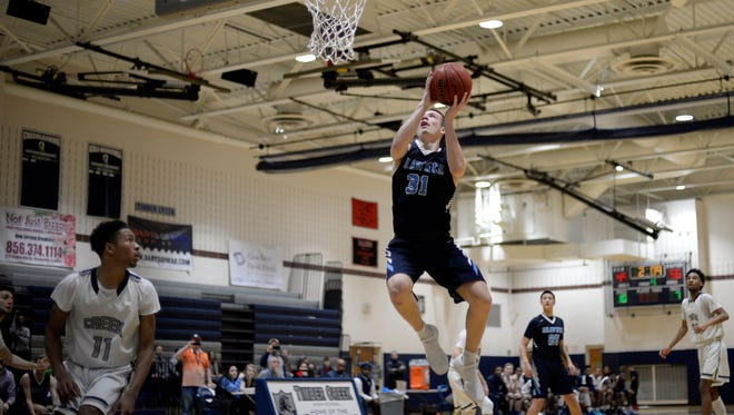 Shawnee's Dean Noll (31) drives to the basket against Timber Creek Tuesday, Feb. 13, 2018 in Sicklerville, N.J. Loll scored 32 points in Shawnee's 67-56 victory.