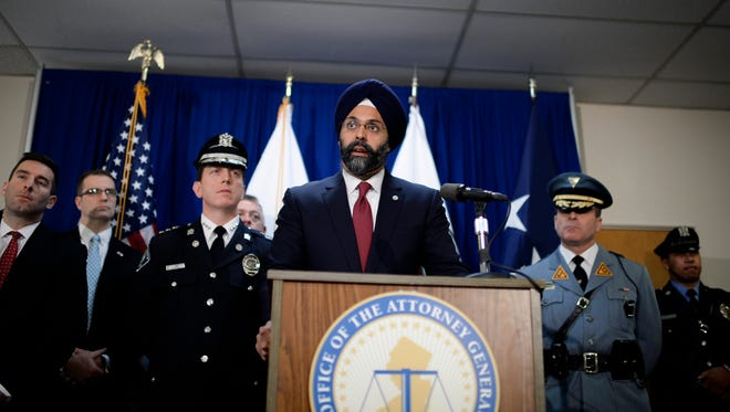 Attorney General Gurbir S. Grewal speaks during a press conference regarding arrests made in a gun trafficking ring from Ohio to Camden Wednesday, Feb. 14, 2018 in Camden, N.J.