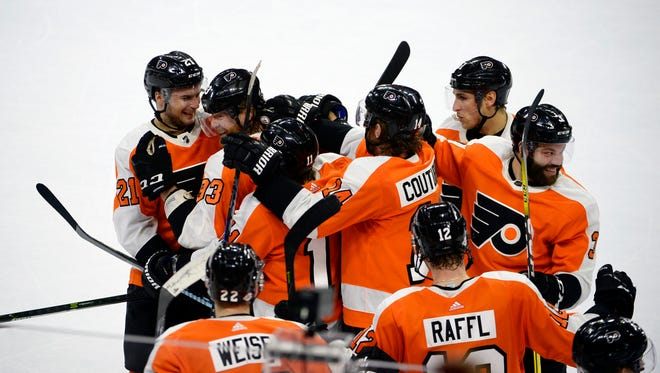 Flyers celebrate a 3-2 overtime victory against the Montreal Canadiens Tuesday, Feb. 20, 2018 at the Wells Fargo Center in Philadelphia.