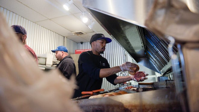 Charles Camper works the grill at Outlaw's Burger Barn & Creamery Friday, March 9, 2018 in Vineland.